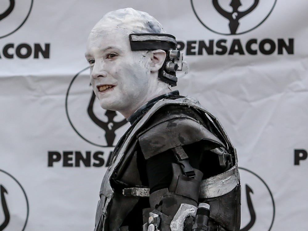 Pensacon cosplayers wait for guests to have their picture taken with them during the 84th annual Pensacola Interstate Fair on Monday, October 22, 2018.