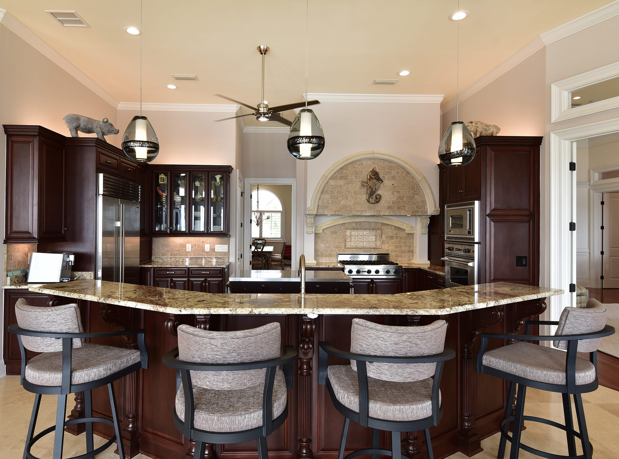 5 Colley CoveThe kitchen includes bar seating.