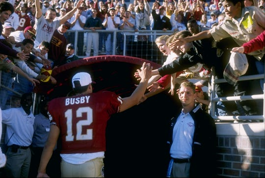 15 Nov 1997: Quarterback Thad Busby #12 of Florida State is congratulated by fans during the Seminoles 58-7 win over Wake Forest at Doak Campbell Stadium in Tallahassee, Florida.