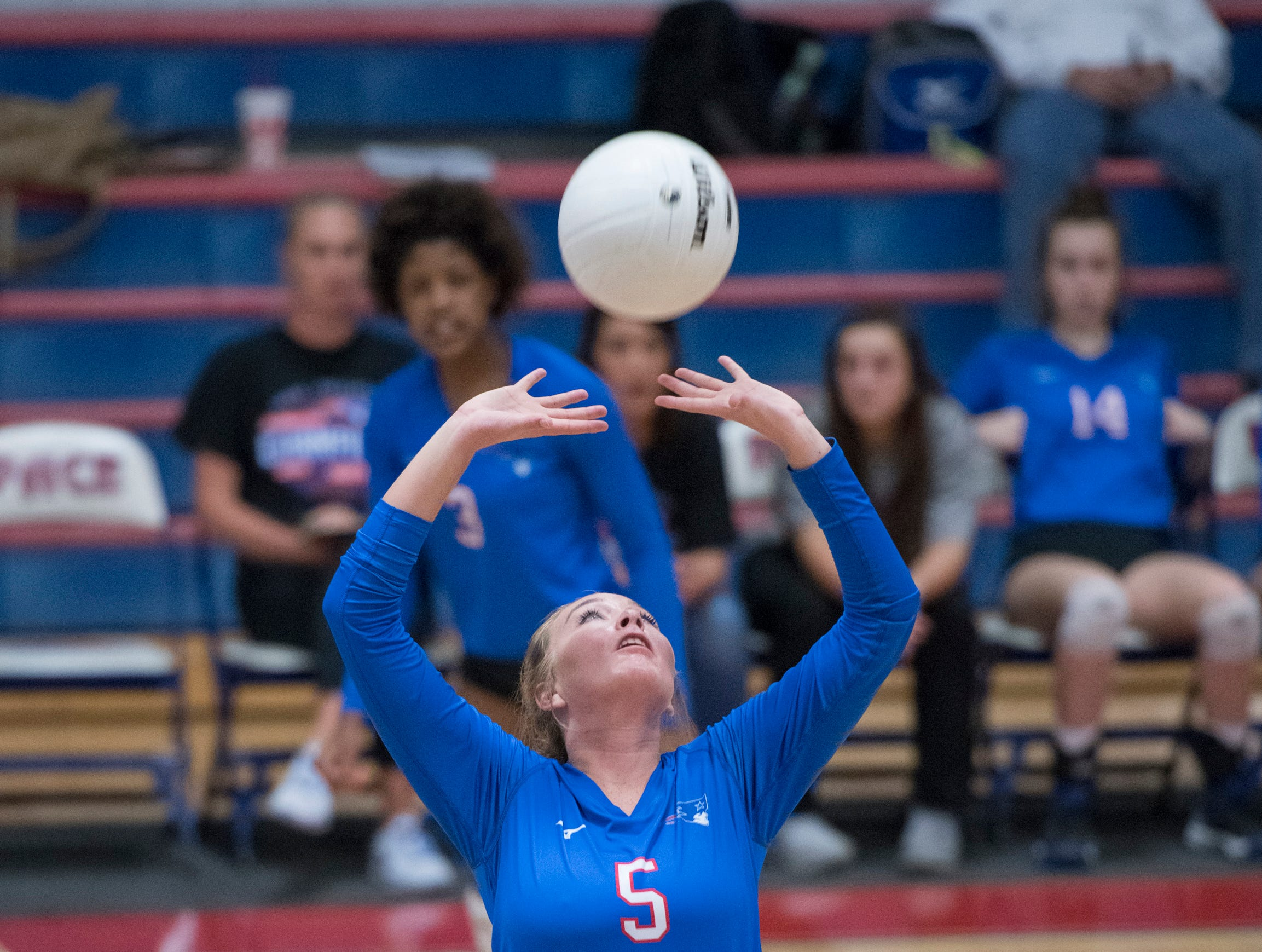 Grace McCammon (5) sets the ball during the regional volleyball game between Fort Walton Beach and Pace at Pace High School on Wednesday, October 24, 2018.