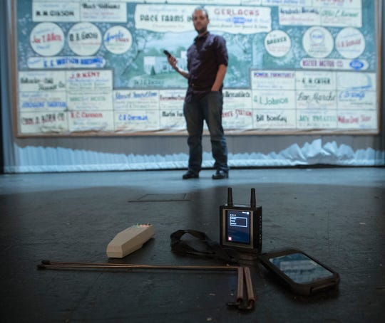Dennis Gleason, event coordinator at the Imogene Theatre in Milton, checks out the ghost hunting gear on the stage Thursday.