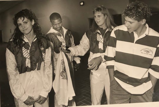 Olympians (from left) Beth Barr, Roy Jones Jr., Andrea Hayes and Daniel Watters wait outside in the hall before a pep assembly at Booker T. Washington High in October 1988.