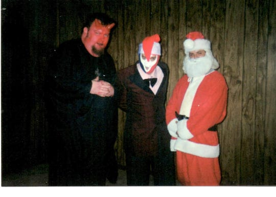 """From left, Mike Ensley in his early incarnation, circa 2001, as Baron Mondo Von Doren; Chip Chism as El Sapo de Tempesto; and Santa, played by Brent Burton, who is the executive producer of the new """"Nightmare Theatre"""" on WSRE."""