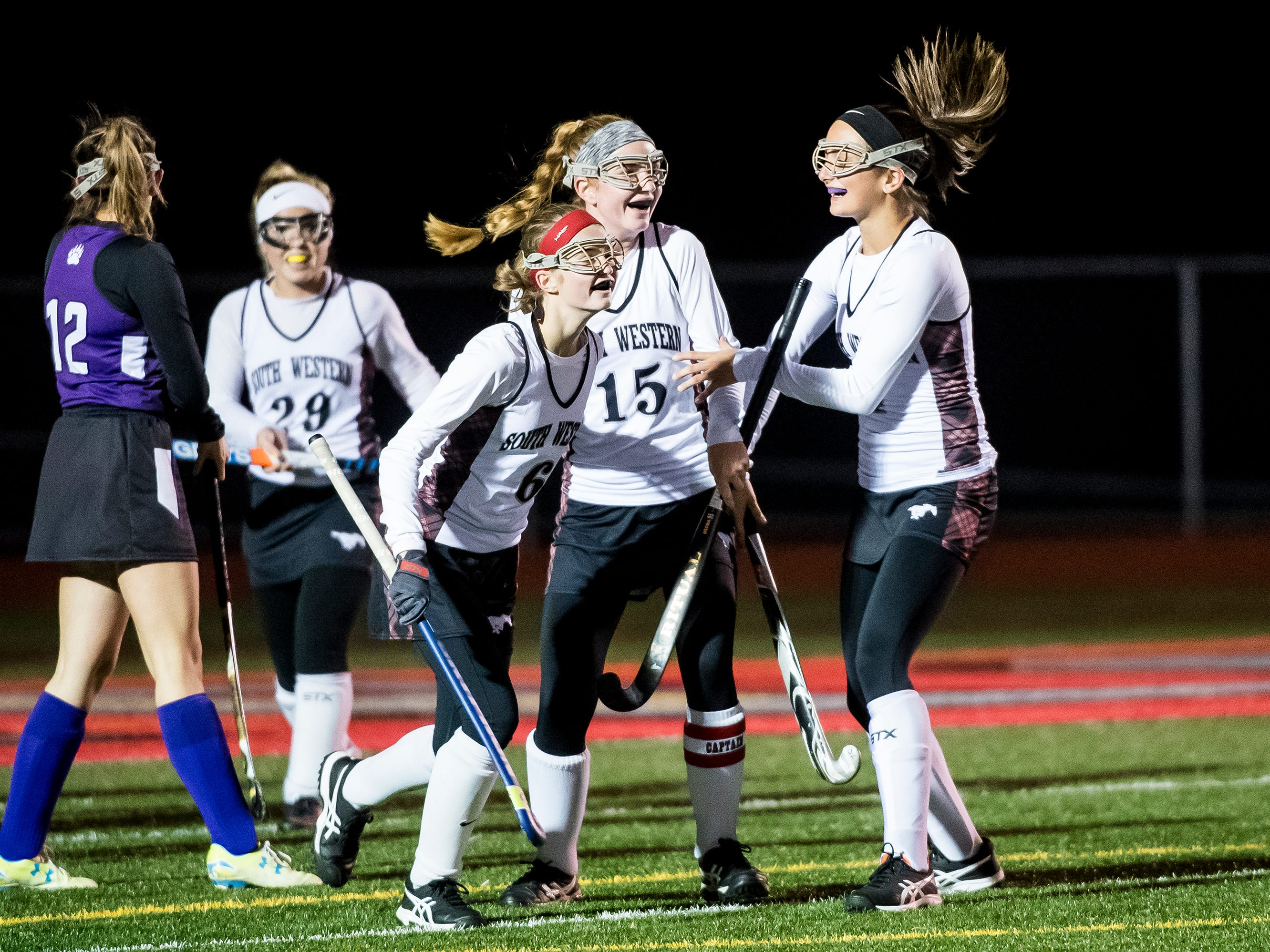 South Western players celebrate after scoring a goal against Northern during a PIAA District III first round game at Bermudian Springs High School on Wednesday, October 24, 2018. The Mustangs fell 4-2.