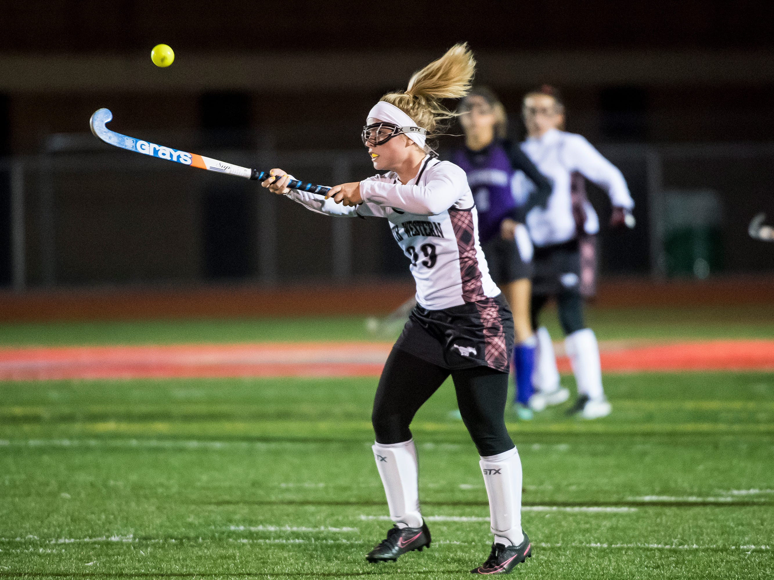 South Western's Albanie Hersh hits the ball in mid-air during play against Northern in a PIAA District III first round game at Bermudian Springs High School on Wednesday, October 24, 2018. The Mustangs fell 4-2.