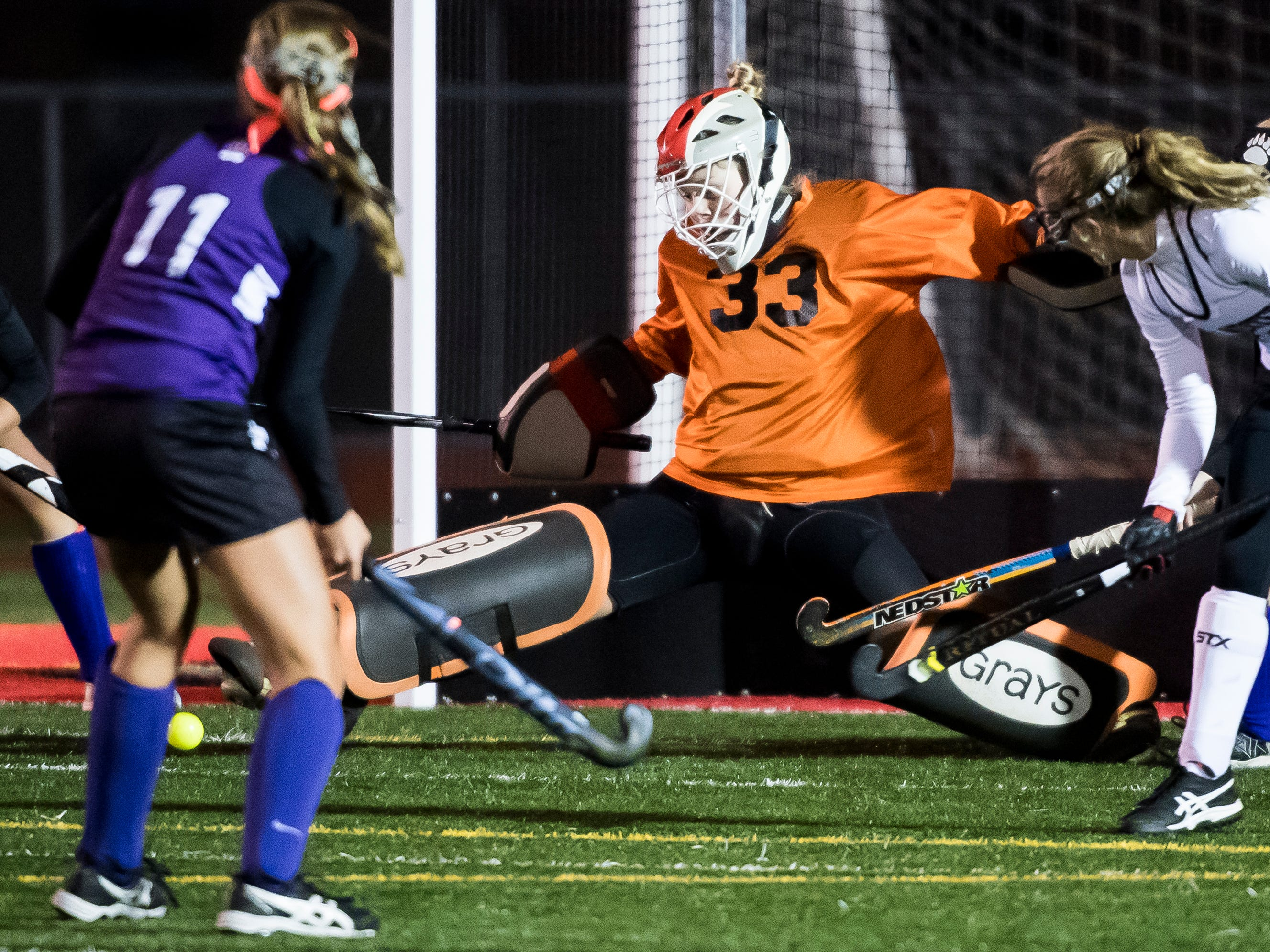 South Western goal keeper Aunnie Hacker makes a save off a Northern York shot during a PIAA District III first round game at Bermudian Springs High School on Wednesday, October 24, 2018. The Mustangs fell 4-2.