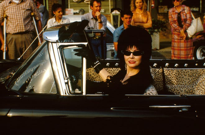 """Cassandra Peterson goes for a ride in """"Elvira: Mistress of the Dark."""""""