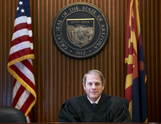 Former state representative and current Highland District Court Justice of the Peace Steve Urie brings to his elected position, a seasoned and pragmatic approach. He sits at his new bench in Gilbert's court complex, on Feb. 22, 2013.