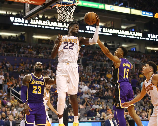 Deandre Ayton rebounds a missed shot by the Lakers' LeBron James during the second half of the Suns' 131-113 loss to the Lakers on Talking Stick Resort Arena.