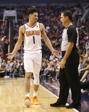 Phoenix Suns' Devin Booker receives a technical foul by offical David Guthre against the Los Angeles Lakers in the first half during a game on Oct. 24 at Talking Stick Resort Arena.