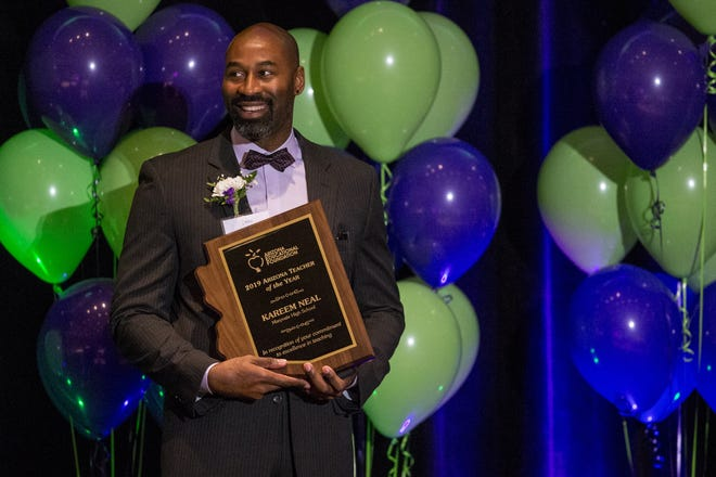 Maryvale High School's Kareem Neal accepts the award for Arizona Teacher of the Year on Thursday, Oct. 25, 2018, at the Arizona Biltmore in Phoenix.