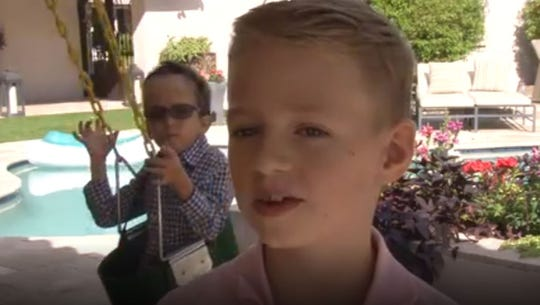 Eight-year-old Harrison More (foreground) told the crowd at the Oct. 13 Foundation for Blind Children fundraiser about his brother Henry, 7. Henry is legally blind, deaf and autistic and attends school through the foundation.
