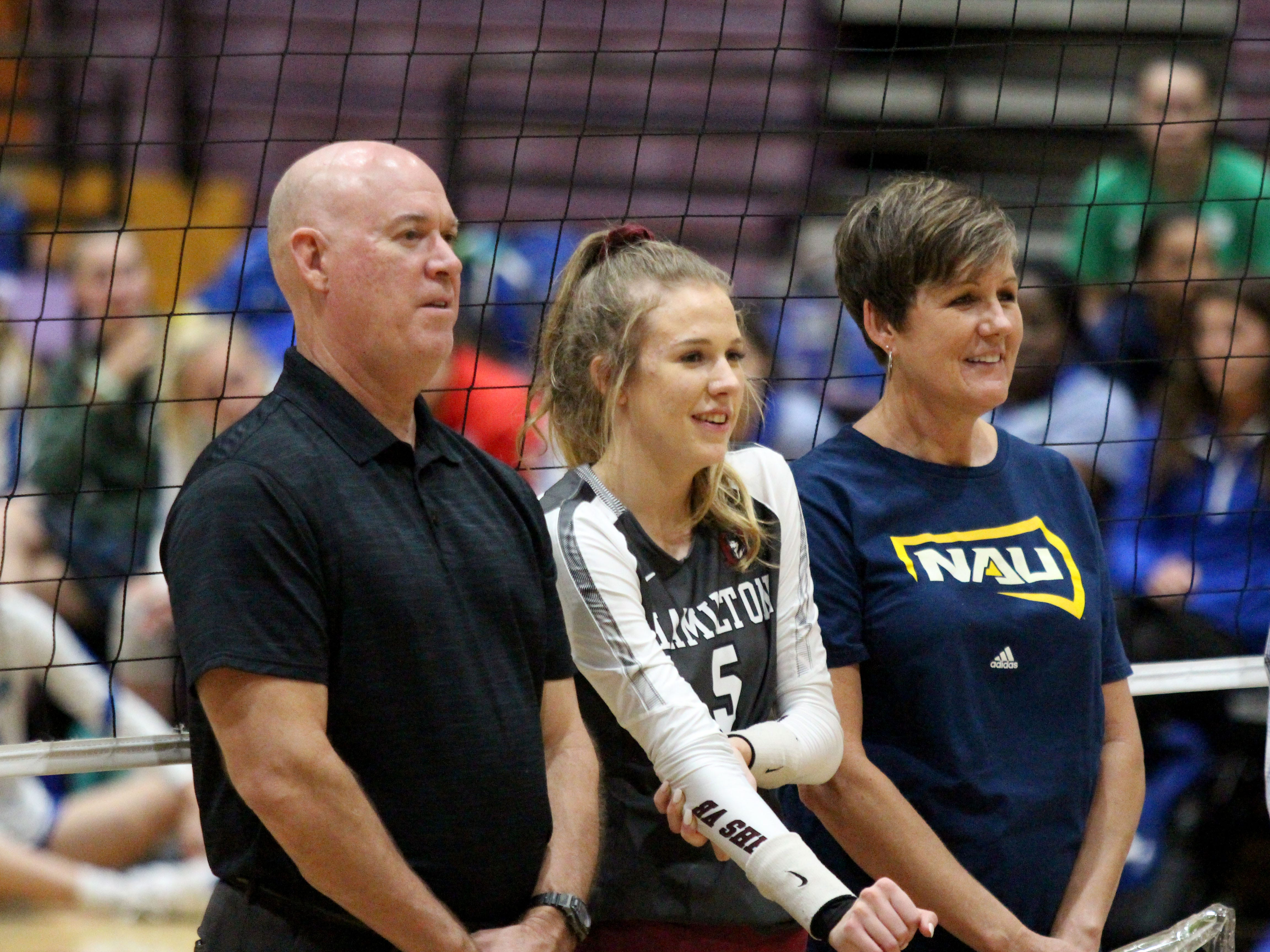 Hamilton's Taylor Jacobsen stands by her her parents on senior night before the team's game against Xavier College Prep on Tuesday night at Hamilton High School on Oct. 23, 2018.