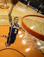 Lakers guard Lonzo Ball goes up for a dunk during the second half of a game against the Suns on Oct. 24 at Talking Stick Resort Arena.