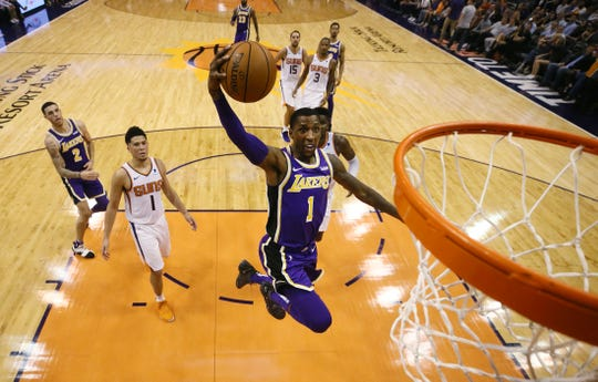 Los Angeles Lakers' Kentavious Caldwell-Pope dunks the ball against the Phoenix Suns during a game on Oct. 24 at Talking Stick Resort Arena.