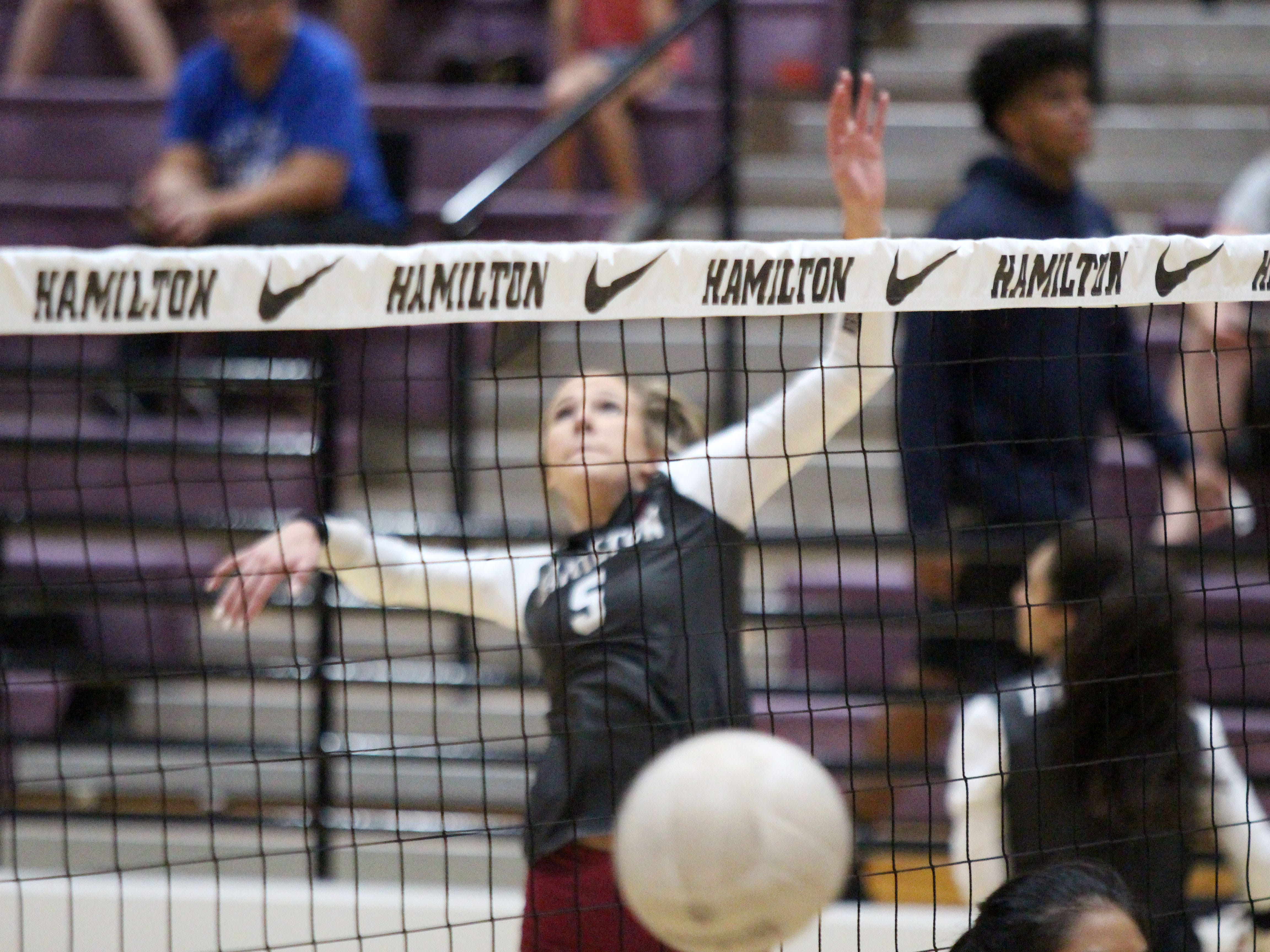 Hamilton's Taylor Jacobsen practices spiking the ball before the team's game against Xavier College Prep on Tuesday night at Hamilton High School on Oct. 23, 2018.