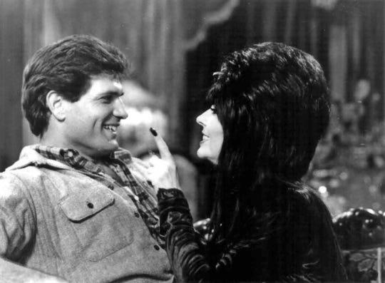 "Daniel Greene and Cassandra Peterson star in ""Elvira: Mistress of the Dark."""