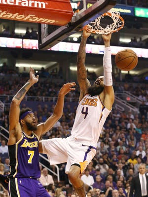 Phoenix Suns' Tyson Chandler dunks the ball against the Los Angeles Lakers in the first half during a game on Oct. 24 at Talking Stick Resort Arena.