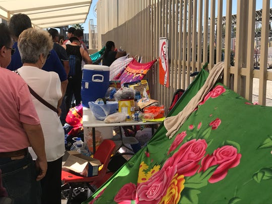 Migrants camped out on the Mexican side of the San Luis border crossing on Oct. 24, 2018, depend on non-profits and handouts from the community for meals. They must use the restrooms located at the Mexican customs facility.