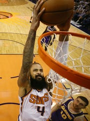 Phoenix Suns' Tyson Chandler slam-dunks against the Los Angeles Lakers during a game on Oct. 24 at Talking Stick Resort Arena.