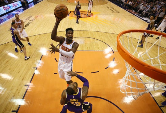 Suns rookie Deandre Ayton shoots over LeBron James of the Lakers during a game Oct. 24 at Talking Stick Resort Arena.