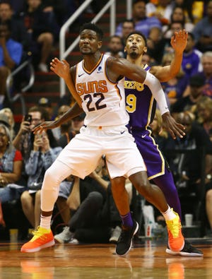 Deandre Ayton works against Lakers forward Johnathan Williams during the Suns' 131-113 loss to the Lakers on Wednesday at Talking Stick Resort Arena.