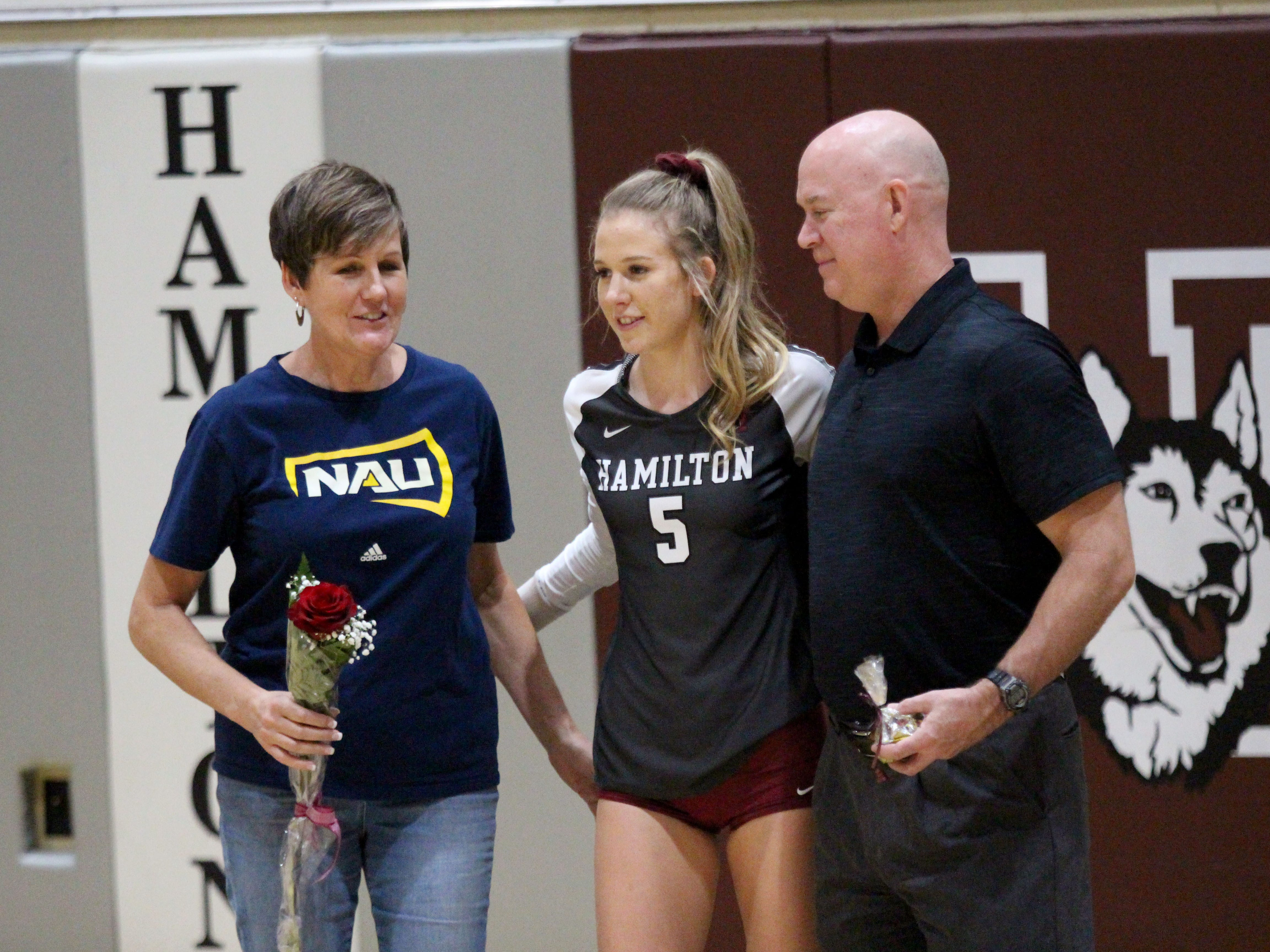 Hamilton's Taylor Jacobsen takes a photo with her parents on senior night before the team's game against Xavier College Prep on Tuesday night at Hamilton High School on Oct. 23, 2018.