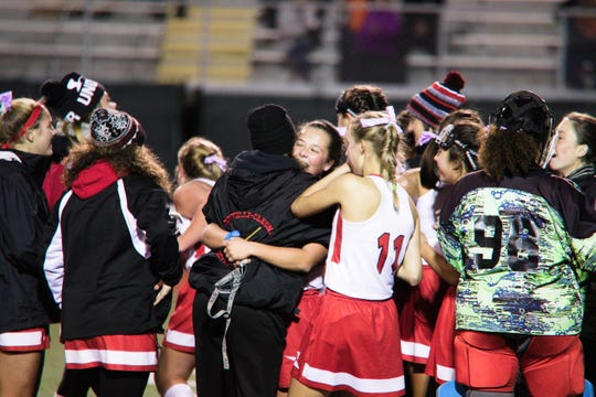 A joyful group of Annville-Cleona field hockey players celebrate Wednesday's 2-1 overtime win over Bishop McDevitt.