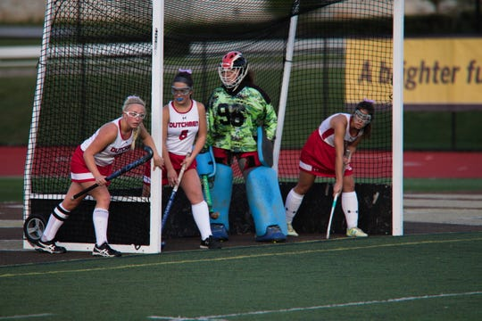 Annville-Cleona defenders get set to charge out of the cage to stop a penalty corner.