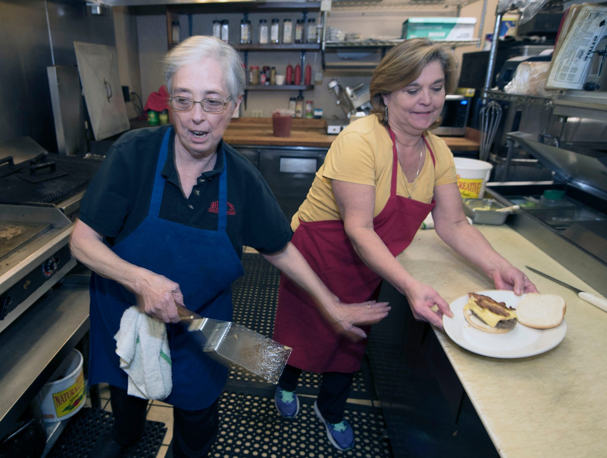 Sandy Mowen, left, and Del Mills' daughter Rene Tolbert work in the kitchen. Health problems experienced by Dilly's owners Del Mills and Sandy Mowen were cited as a reason they are closing the Chambersburg restaurant.