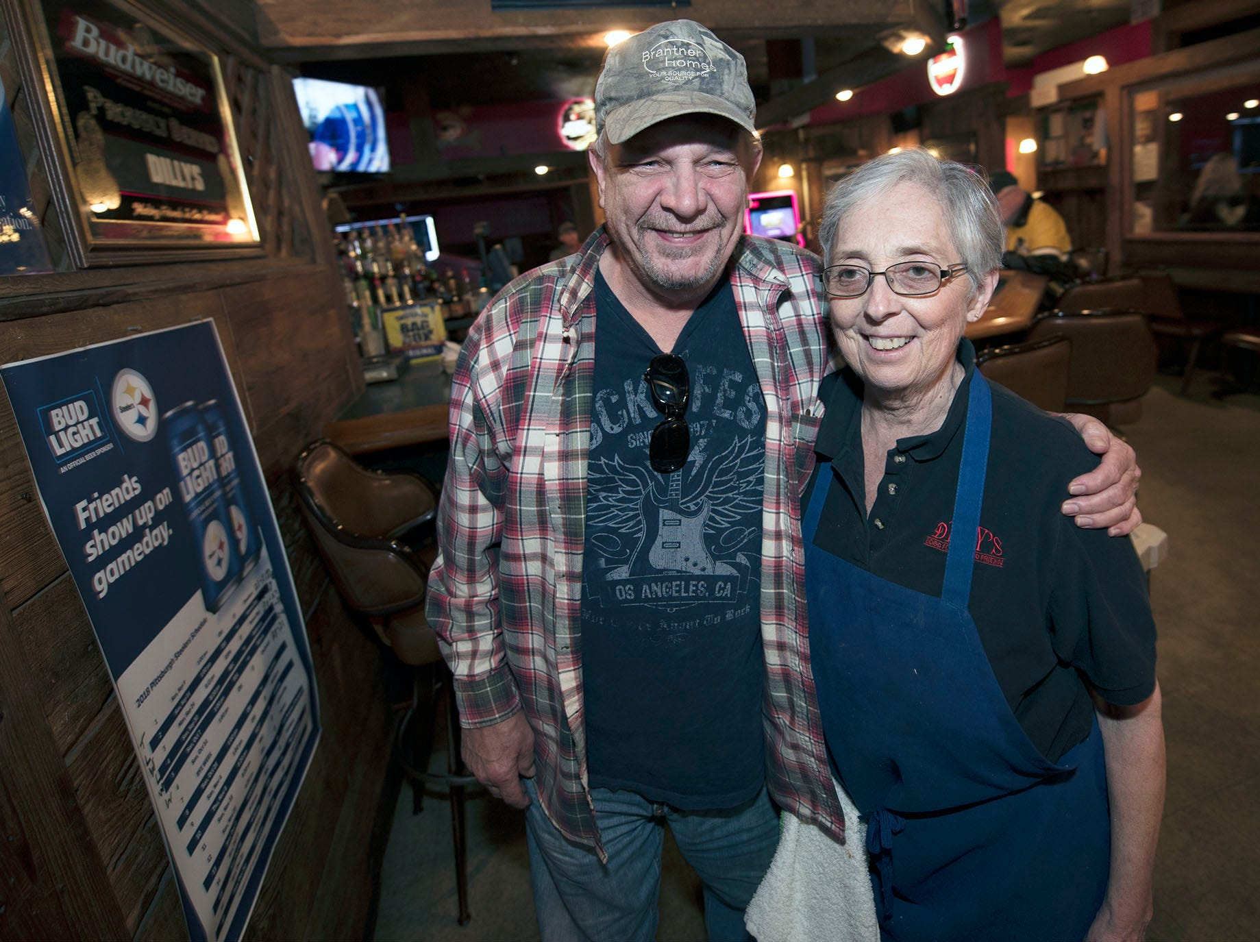 Chuck Orr hugs Sandy Mowen at Dilly's worked at the restaurant for over 20 years. Health problems experienced by Dilly's owners Del Mills and Sandy Mowen were cited as a reason they are closing the Chambersburg restaurant.