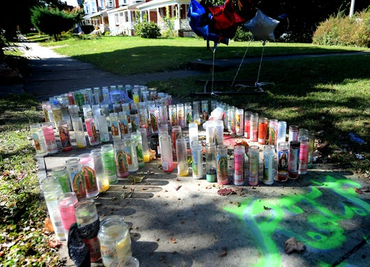 "A memorial occupies the area Thursday, Oct. 25, 2018, where Ruban Dejesus, 17, was fatally shot in the 600 block of Linden Ave. Sunday, Oct. 21. Candles were arranged in a heart shape and an ""R"". Police are searching for 20-year-old Marquis ""Marky"" Treavon Butts, wanted in connection with the homicide. Bill Kalina photo"