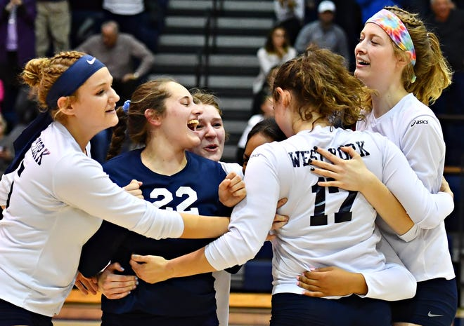 West York celebrates a 3-0 win over Delone Catholic during York-Adams League girls' volleyball championship action at Dallastown Area High School in York Township, Wednesday, Oct. 24, 2018. Dawn J. Sagert photo
