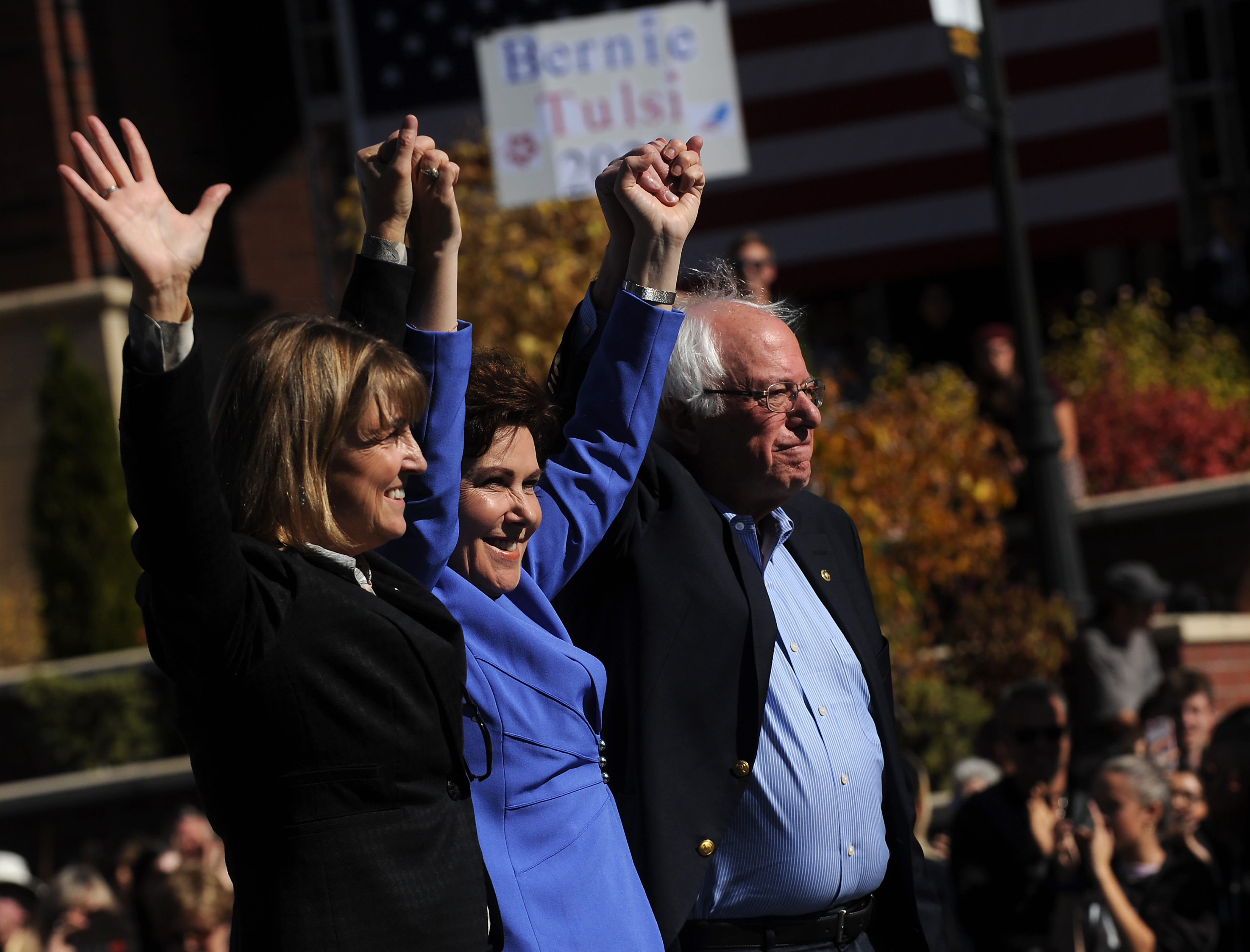 Senator Bernie Sanders, right, campaigns for Nevada Democrats U.S. Rep. Jacky Rosen, middle, and Kate Marshall, Democratic candidate for Nevada lieutenant governor, on the University of Nevada, Reno campus on Oct. 25, 2018.