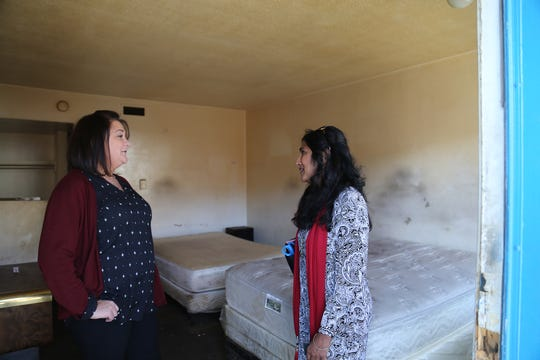 Kelli Wilson, left, and Meera Rosser of Jacobs Entertainment show one of the old rooms from the former Crest Inn in downtown Reno on Oct. 25, 2018. The property will be renovated as part of the new Renova Flats.