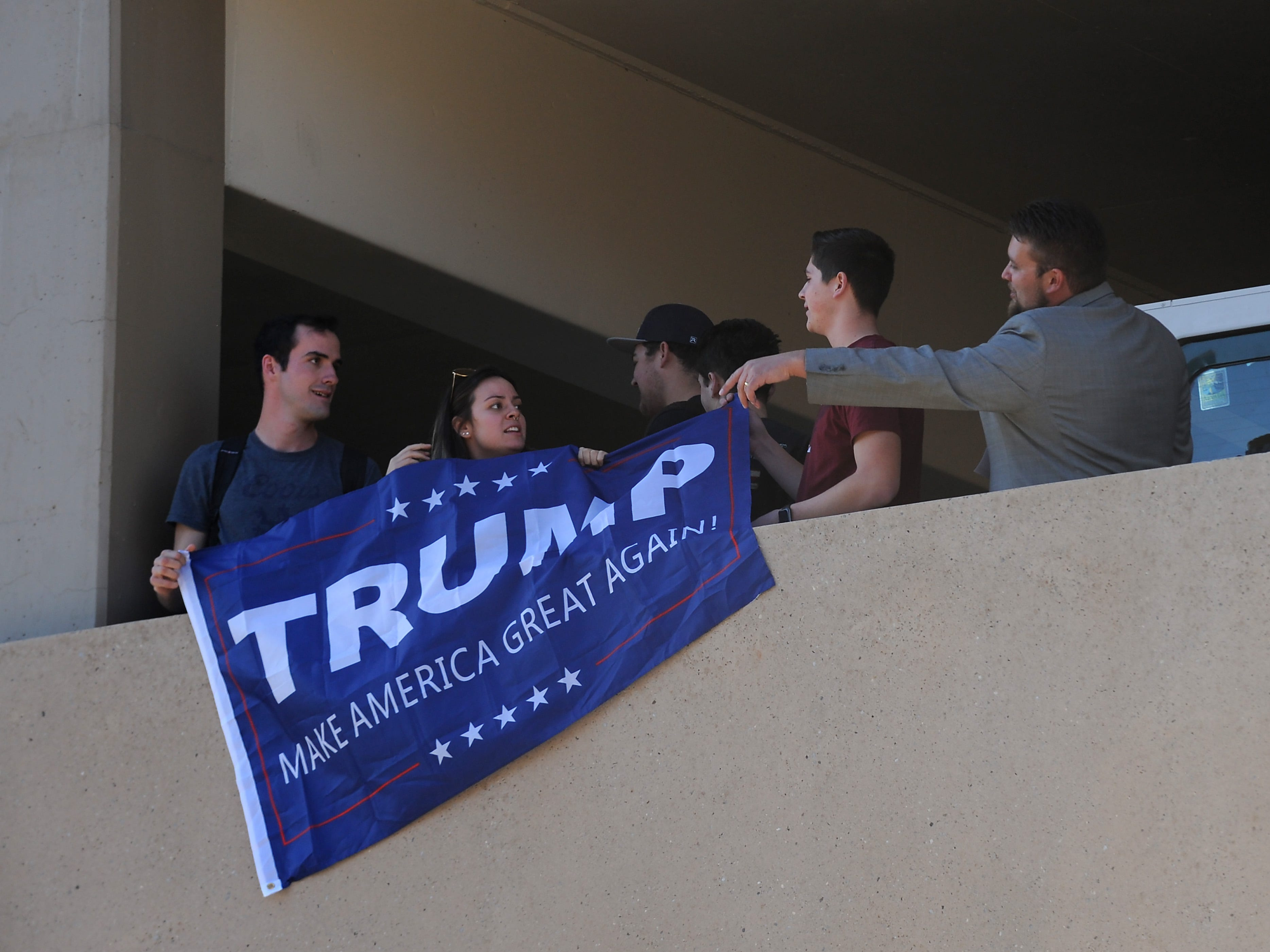 A group of Trump supporters is asked to leave as Senator Bernie Sanders campaigns for Nevada Democrats on the University of Nevada, Reno campus on Oct. 25, 2018.