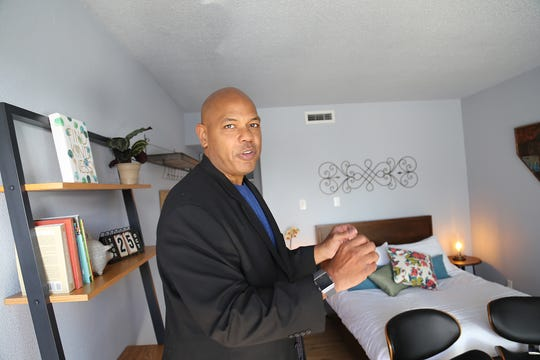 Jonathan Boulware, Jacobs Entertainment vice president of Nevada operations, shows off a remodeled room for the company's Renova Flats project on Oct. 25, 2018.