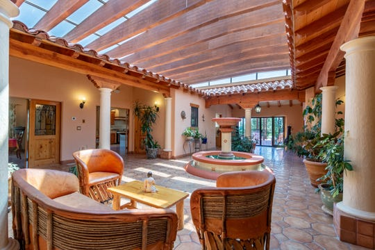 The rooms at Bertha Miranda's South Suburban Reno hacienda-style home are arranged around an atrium with a fountain in its center.