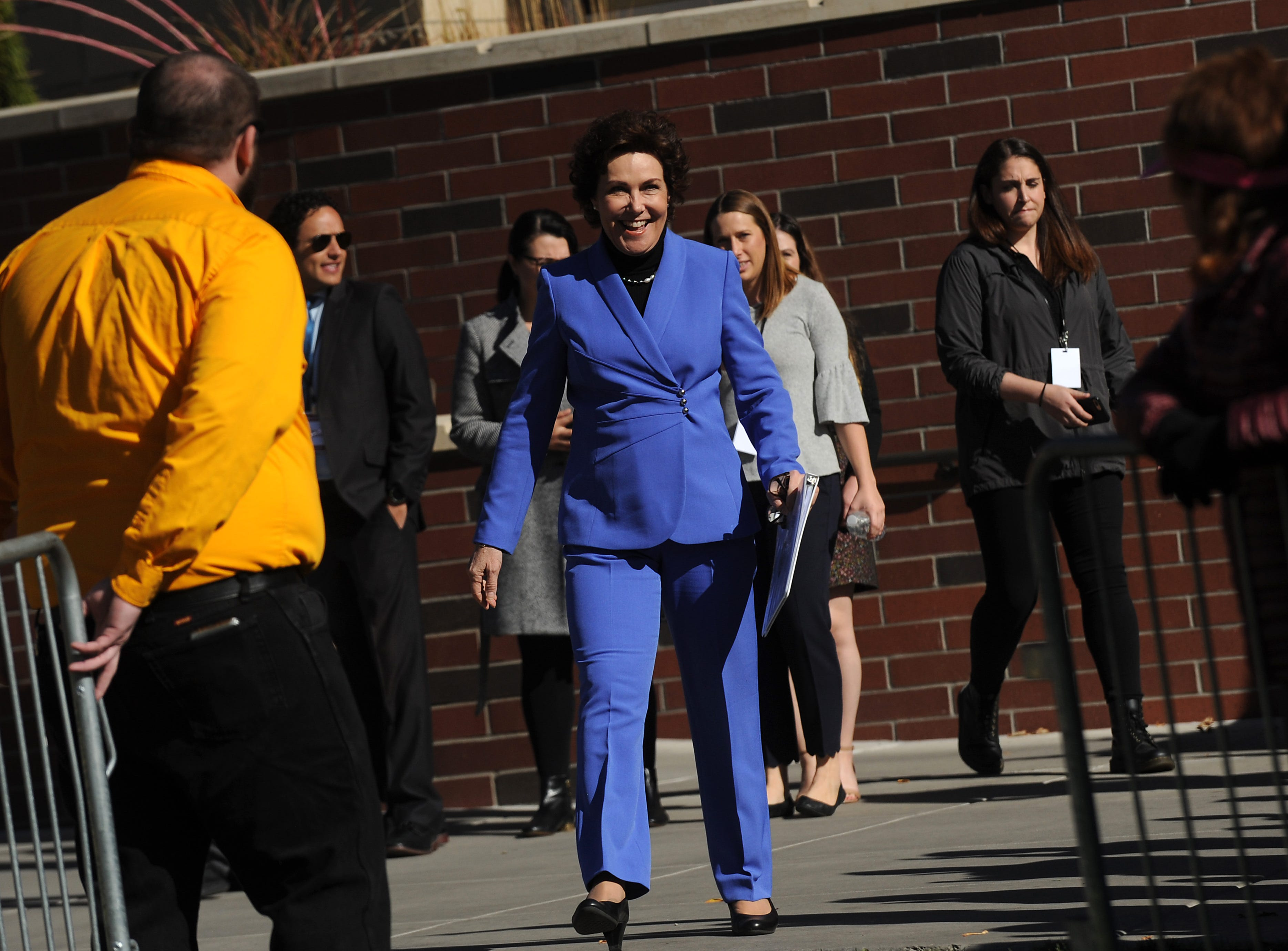 U.S. Rep. Jacky Rosen, D-Nev., who is challenging Dean Heller for the U.S. Senate, heads towards the stage to speak on the University of Nevada, Reno campus on Oct. 25, 2018.