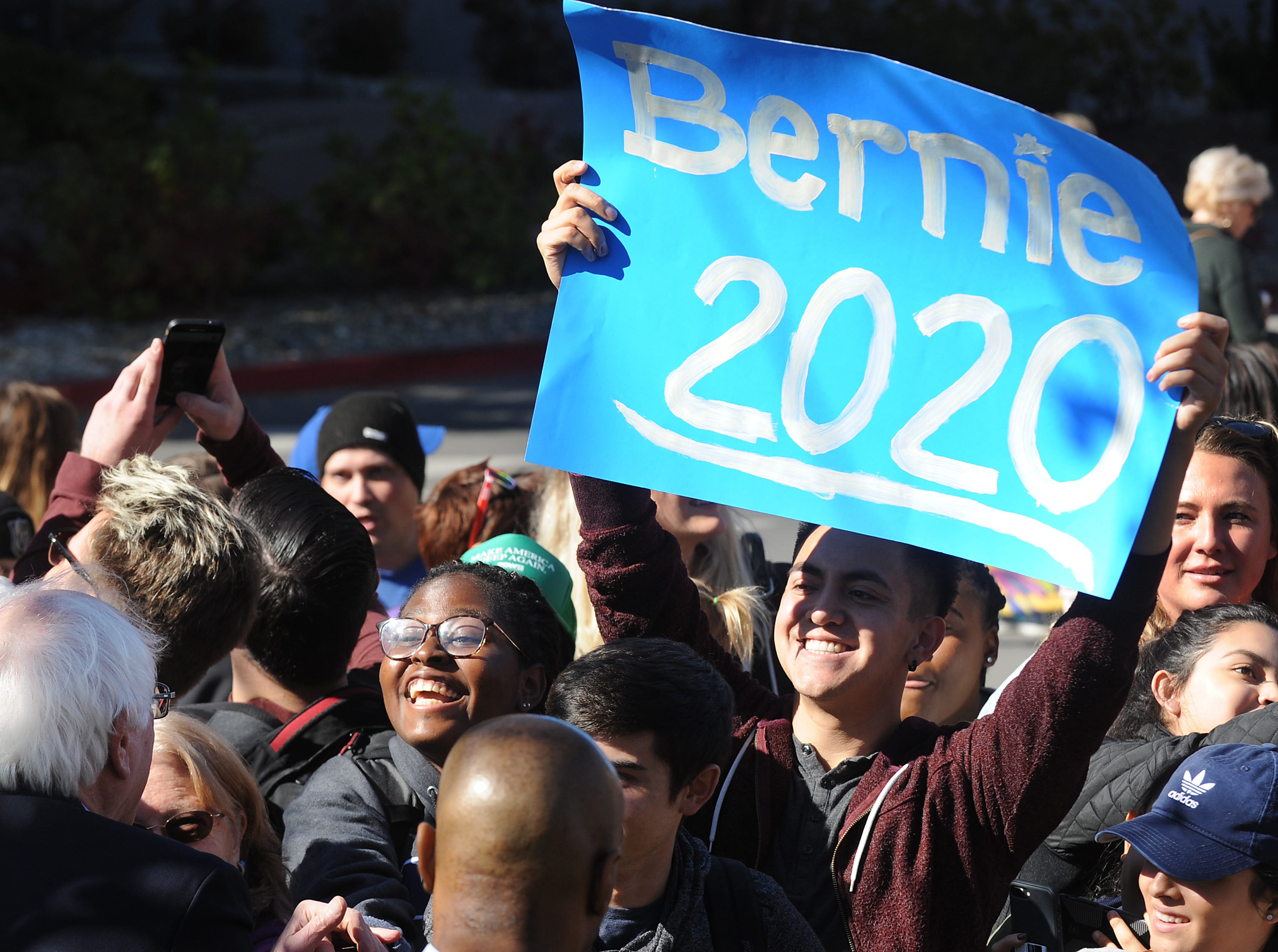 Senator Bernie Sanders greets supporters while campaigning for Nevada Democrats on the University of Nevada, Reno campus on Oct. 25, 2018.