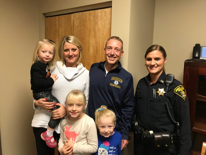 Jody Wyant, second from right, with his wife, daughters and Deputy Jayme Woodin (right). Wyant and Woodin rescued a woman from a burning house on Oct. 24, 2018.