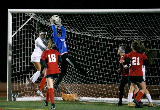 A save by Penfield goalie Abenaa Baffoe with Victor's Olivia Damico behind her in the first half at Eastridge High School.
