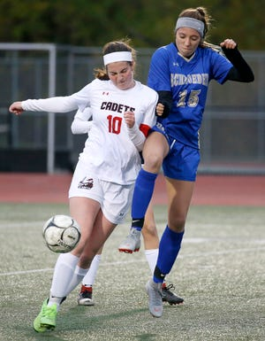 Hilton's Katie Annable protects the ball from Webster Schroeder's Katelyn Rieger in the first half at Eastridge High School.