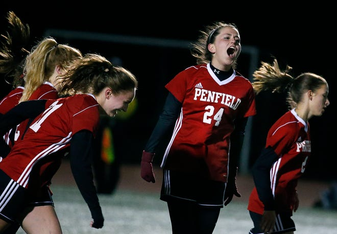 Penfield's Karleigh DeLass reacts after scoring for a 1-0 lead over Victor in the first half at Eastridge High School. Penfield advanced to the Section V Class AA final on penalty kicks.