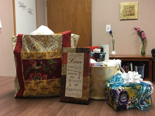 One of three piles of letters and gifts of encouragement received by Rachel Pilli waits for delivery to the couple whose trailer accident started the Carr Fire.