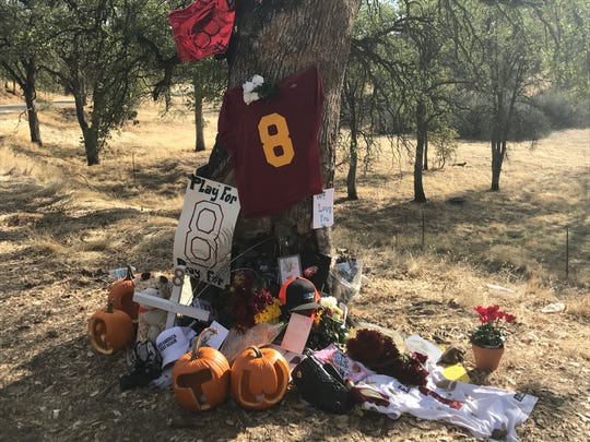 Friends of Tyson Wacker left items near the site of his crash on Rhonda Road in Anderson to memorialize the 16-year-old from West Valley High School.