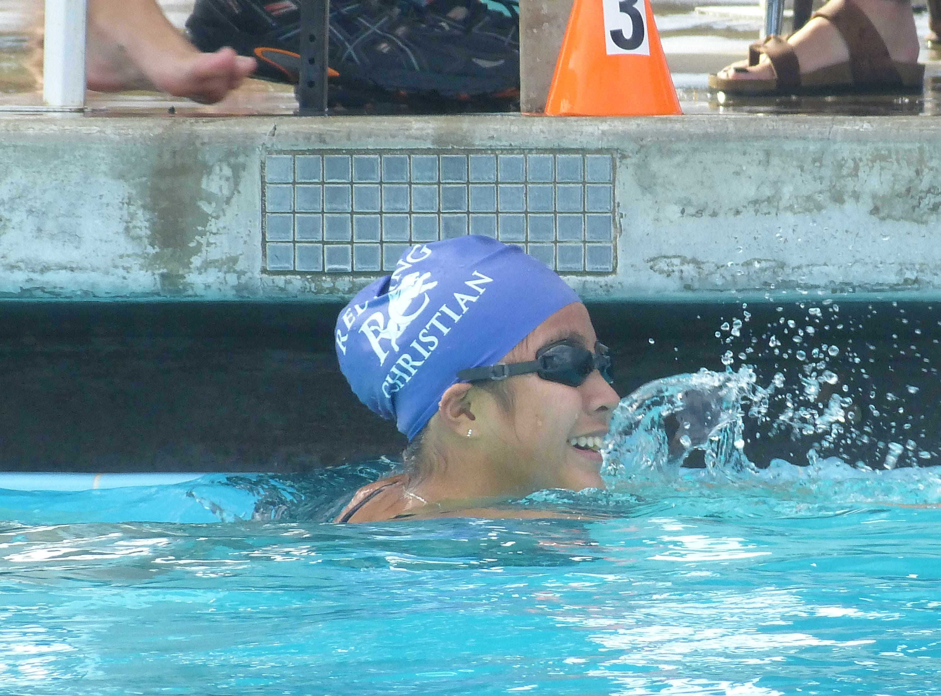 Katherine Sze of Redding Christian looks to shake hands with an opponent after swimming in the 100-yard freestyle Wednesday at the NSCIF trials for Division 2 schools at West Valley High School on Oct. 24, 2018.