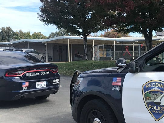Redding police check the Stellar Charter School and Redding School District offices on East Bonnyview Road after the a bomb threat was phone in to the district earlier this year.