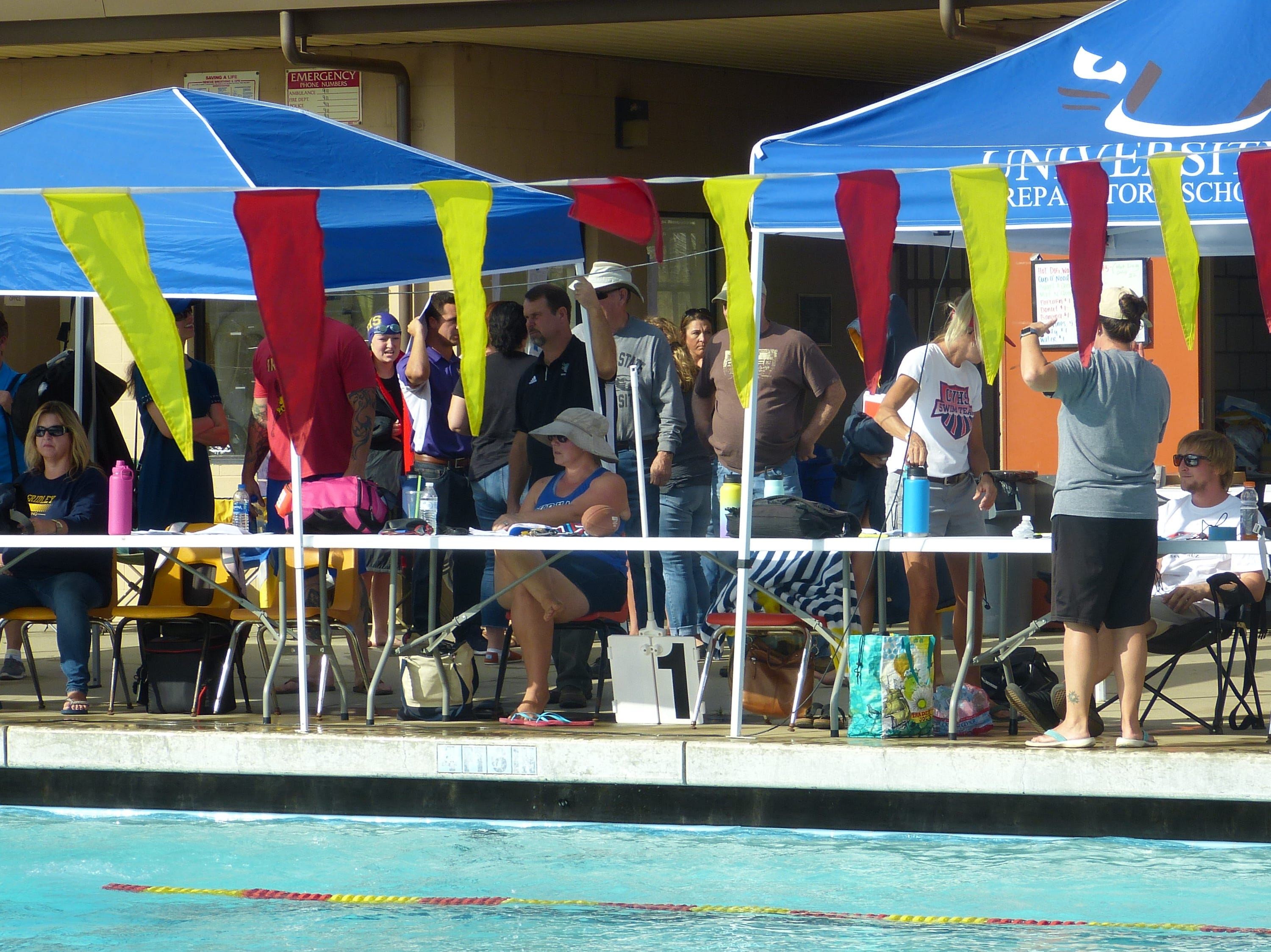 Coaches watch their swimmers compete Wednesday at the NSCIF trials for Division 2 schools at West Valley High School on Oct. 24, 2018.