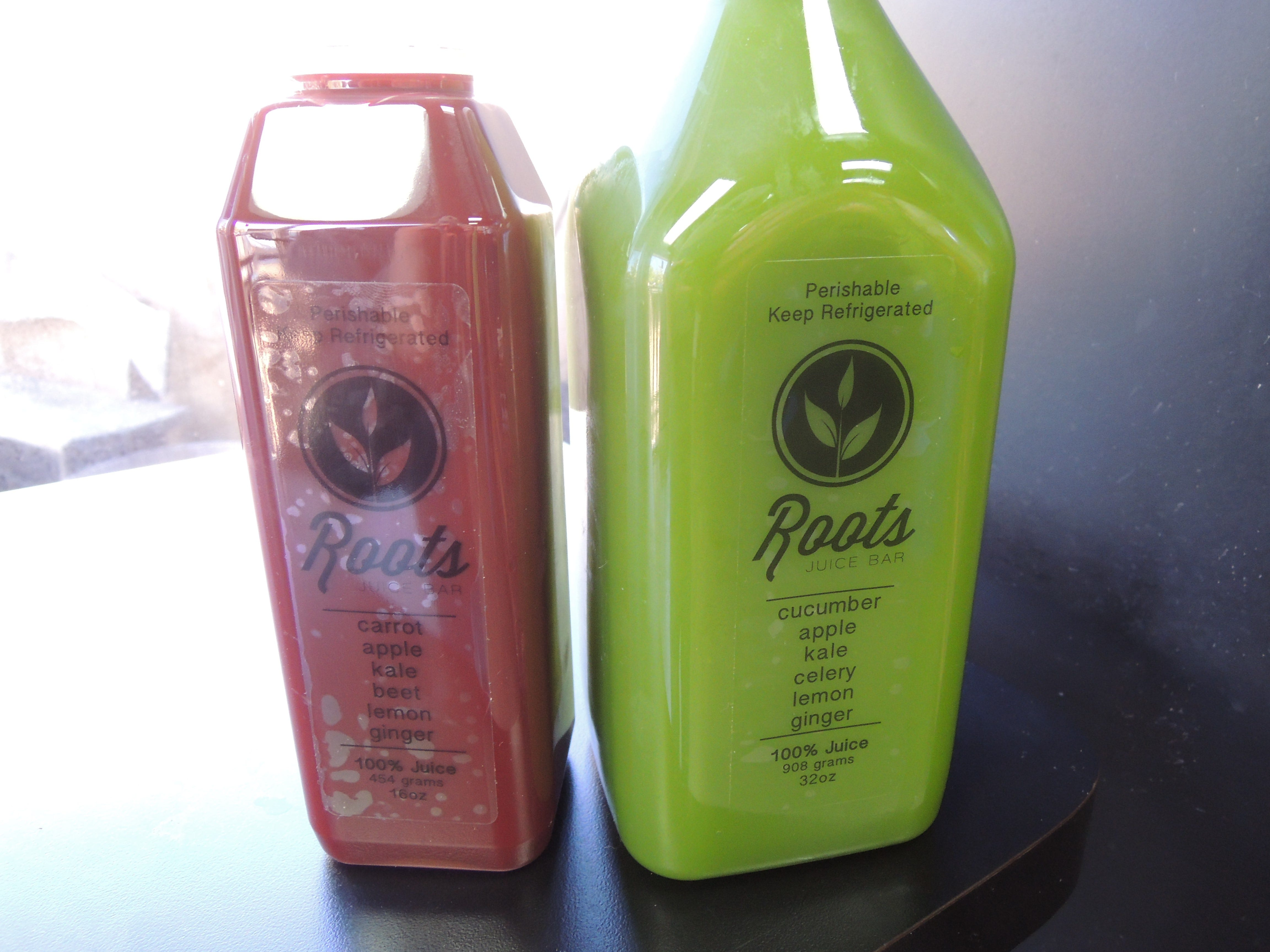 Two of the grab-and-go drinks in the refrigerator at Roots Juice Bar in east Redding.